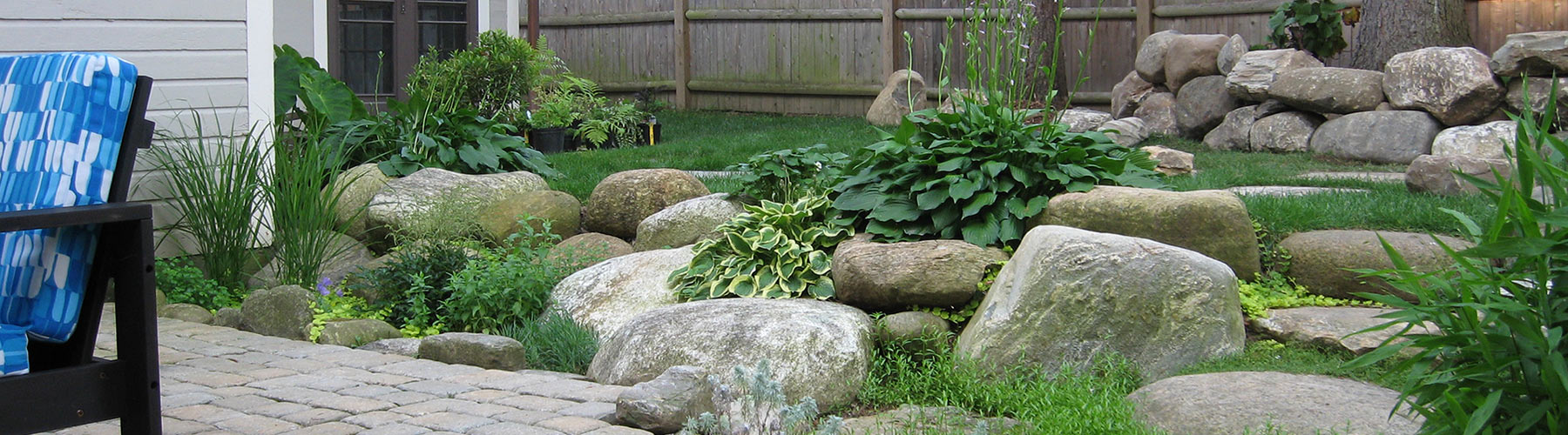 Boulders with hostas